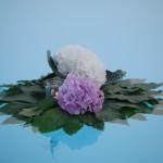 Composizione piscina con ortensie e candele - Pepe Rosa Eventi